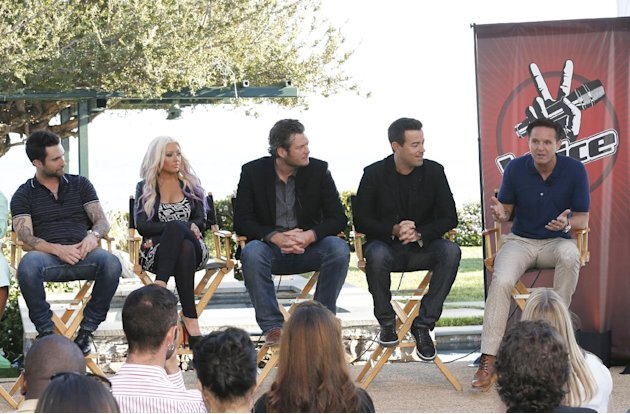 This Sinday, Aug. 12, 2012 photo released by NBC shows from left,  coaches Adam Levine, Christina Aguilera, and Blake Shelton, host Carson Daly and producer Mark Burnett at a news coference for the si