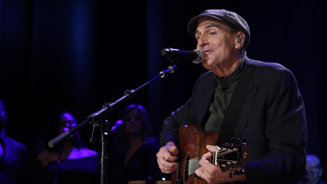 FILE - This Oct. 21, 2012 file photo shows James Taylor at the Country Music Hall of Fame Inductions in Nashville, Tenn. Aerosmith, James Taylor, and Jimmy Buffett are among the scheduled performers for a Boston Marathon benefit concert May 30. The show, at the TD Garden, will benefit One Fund _ the collection of donations that will be distributed to the survivors of the April 15 bombings and the families of those killed in the attack. (Photo by Wade Payne/Invision/AP, file)
