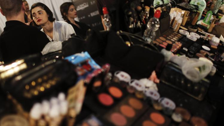 A model has her make-up done backstage during Tel Aviv Fashion Week