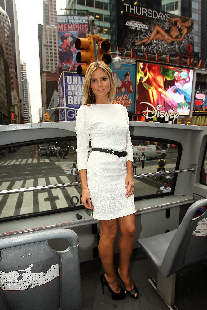 "Heidi Klum poses for photos while promoting the launch of the new season of ""Project Runway"" in New York's Times Square on Thursday, July 19, 2012. The fashion competition series, now in it's tenth season, premieres Thursday at 9 p.m. EST on Lifetime. (Photo by Donald Traill/Invision/AP)"