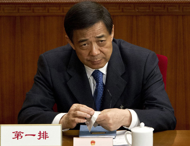 FILE - In this March 11, 2012 file photo, then Chongqing party secretary Bo Xilai attends a plenary session of the National People&#39;s Congress at the Great Hall of the People in Beijing. Bo&#39;s wife Gu Kailai who is accused of murdering Bo family associate, British businessman Neil Heywood, went on trial Thursday, Aug. 9, 2012 at the Hefei Intermediate People&#39;s Court in eastern China. Bo&#39;s name was not mentioned at the trial of Gu, who confessed to killing Heywood following a financial dispute and what she said were threats to her son. (AP Photo/Andy Wong, File)