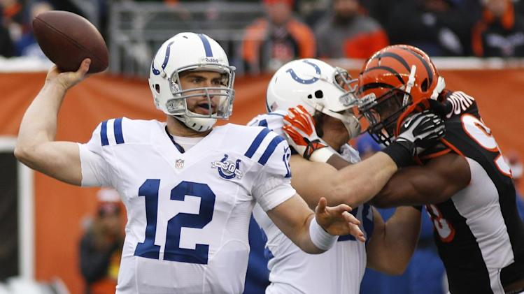 Indianapolis Colts quarterback Andrew Luck (12) passes against the Cincinnati Bengals in the first half of an NFL football game, Sunday, Dec. 8, 2013, in Cincinnati
