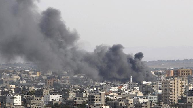 Smoke rises following an Israeli attack in Gaza City, Friday, Nov. 16, 2012. Early Friday, 85 missiles exploded within 45 minutes in Gaza City, sending black pillars of smoke towering above the coastal strip's largest city. The military said it was targeting underground rocket-launching sites. (AP Photo/Adel Hana)