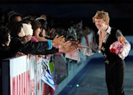 Four Continents figure skating championships men's event winner Canada's Kevin Reynolds is congratulated by spectators during the awards ceremony in Osaka on February 9, 2013. Reynolds took the men's title at the championships in his first major international victory