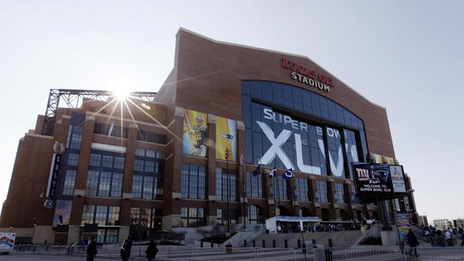 FILE - This Feb. 5, 2012 photo shows the exterior of Lucas Oil Stadium before the NFL Super Bowl XLVI football game in Indianapolis.  In a 54-page report focused on Homeland Security Department spending in the last few years in several states, Sen Tom Coburn, R-Okla, says some projects, including a $250,000 security upgrade at Lucas Oil Stadium, were questionable in an age of budget austerity and as the federal government faces a $16 trillion debt. (AP Photo/Pat Semansky, File)