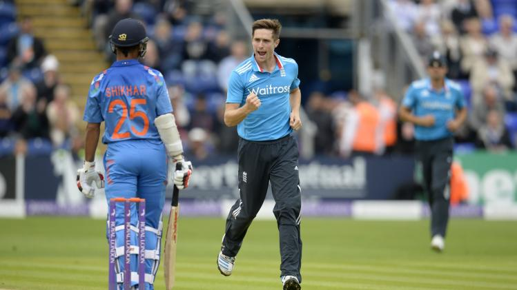 England's Woakes celebrates after dismissing India's Dhawan during the second one-day international cricket match at the SWALEC stadium in Cardiff