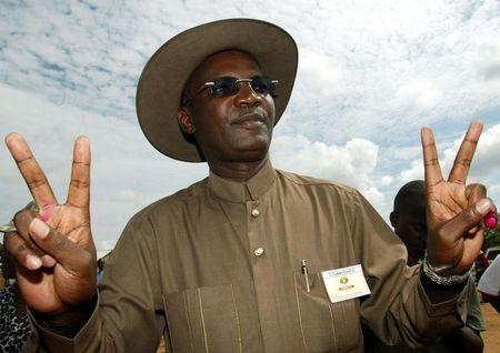 Former Minister of Information Jonathan Moyo makes a victory signs after casting his vote in Zimbabwe.