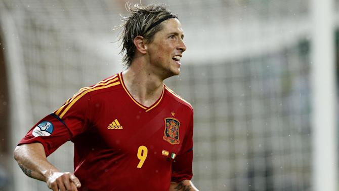 Spain's Fernando Torres celebrates after scoring his side's third goal during the Euro 2012 soccer championship Group C match between Spain and Ireland in Gdansk, Poland, Thursday, June 14, 2012. (AP Photo/Michael Sohn)