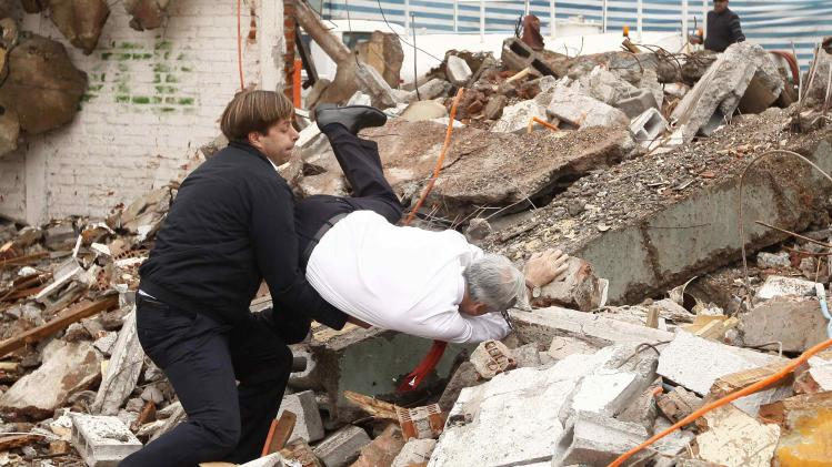 Chile President Pinera falls on debris as Mayor of Puente Alto, German Codina, tries to assist, in Santiago