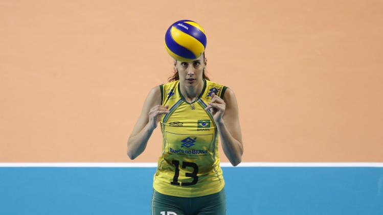 Castro of Brazil plays with the ball before serving to Russia during their FIVB Women's Volleyball World Grand Prix 2014 final round match in Tokyo