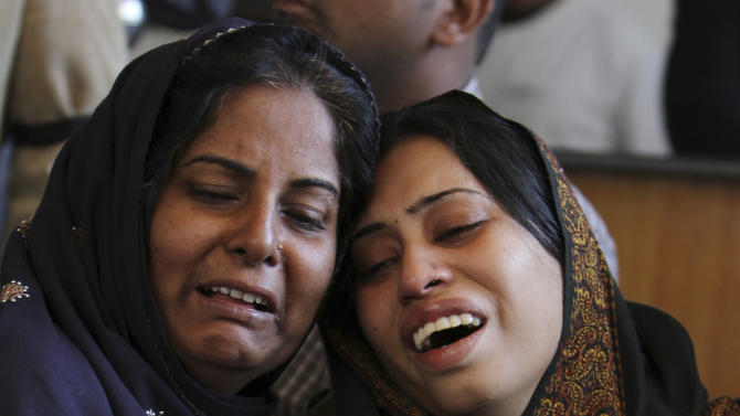 FILE - In this Friday, Jan. 18, 2013, file photo, Pakistani women mourn the death of her family member, during a funeral in Karachi, Pakistan. Over 2,000 people were murdered in Pakistan's largest city last year, but the shooting death of 20-year-old Shahzeb Khan in one of Karachi's most upscale neighborhoods sparked an unusual outcry and highlighted a growing trend of citizens using social media to hold the country's rich and powerful to account. (AP Photo/Fareed Khan, File)