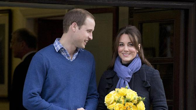 Britain's Prince William stand next to his wife Kate, Duchess of Cambridge as she leaves the King Edward VII hospital in central London, Thursday, Dec. 6, 2012. Prince William and his wife Kate are expecting their first child, and the Duchess of Cambridge was admitted to hospital suffering from a severe form of morning sickness in the early stages of her pregnancy.  (AP Photo/Alastair Grant)
