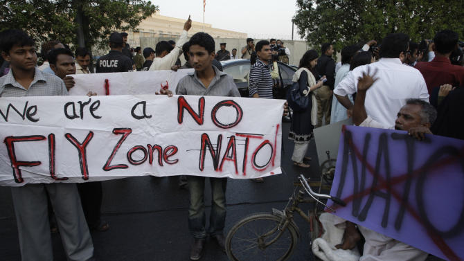 Pakistani university students protest against the NATO airstrikes on Pakistani troops, outside the U. S. consulate in Karachi, Pakistan on Friday, Dec 2, 2011. U.S. officials gave Pakistan soldiers the wrong location when asking for clearance to attack militants along the border last weekend, Pakistani military officials said Friday. The strike resulted in the deaths of 24 soldiers and a major crisis in relations between Washington and Islamabad. (AP Photo/Shakil Adil)
