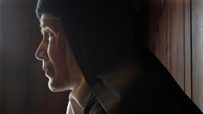 In this Thursday, Dec. 22, 2011 photo, Mother Dolores Hart is interviewed inside the Abbey of Regina Laudis monastery in Bethlehem, Conn. Mother Dolores, a cloistered nun whose luminous blue eyes entranced Elvis Presley in his first on-screen movie kiss, is praying for a Christmas miracle. She walked away from Hollywood stardom in 1963 to become a nun in rural Bethlehem. Now she finds herself back in the spotlight, but this time it's all about serving the King of Kings, not smooching the King of Rock and Roll. The former brass factory that houses Mother Dolores and about 40 other nuns cloistered at the Abbey of Regina Laudis needs millions of dollars in renovations to meet fire and safety codes, add an elevator and make handicap accessibility upgrades. (AP Photo/Jessica Hill)