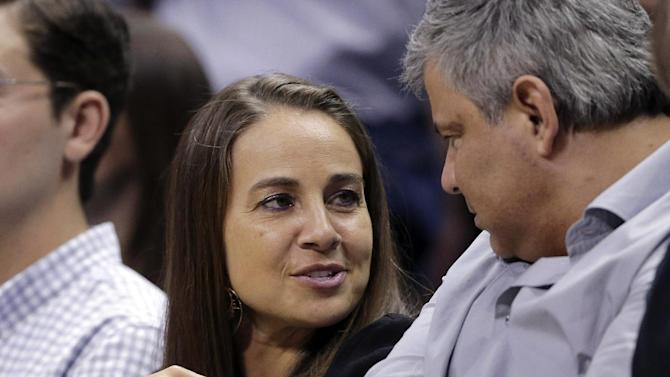 In this April 30, 2014 photo, San Antonio Stars' Becky Hammon attends Game 5 of the opening-round NBA basketball playoff series between the San Antonio Spurs and Dallas Mavericks in San Antonio. Gregg Popovich said that he believes Hammon and other women can cross over and coach men, even in the NBA. (AP Photo/Eric Gay)