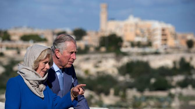Britain's Prince Charles and Camilla, the Duchess of Cornwall, look on during a tour through the old town of Mdina during the Commonwealth Heads of Government Meeting in Mdina