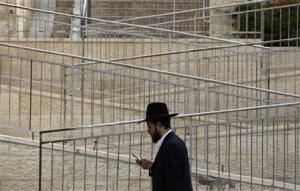 File photo of an ultra-Orthodox Jew holding a mobile phone in Ramat Shlomo