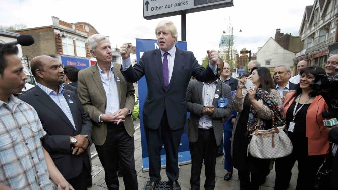 London Mayor Boris Johnson talks to locals and journalists during campaigning in Enfield, north London, Britain