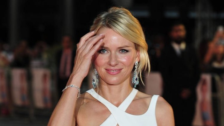 "Naomi Watts poses on the red carpet as she attends the world premiere of ""Diana"" in central London on September 5, 2013"