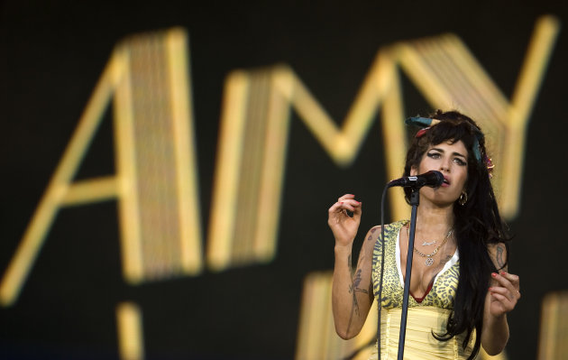 FILE - In this July 4, 2008 file photo, singer Amy Winehouse performs during the Rock in Rio music festival in Arganda del Rey, on the outskirts of Madrid. A second coroner's inquest confirmed Tuesday Jan. 8, 2013, that Amy Winehouse died of accidental alcohol poisoning when she resumed drinking after a period of abstinence. The second inquest was held after the original coroner was found to lack the proper qualifications for the job. (AP Photo/Victor R. Caivano, File)