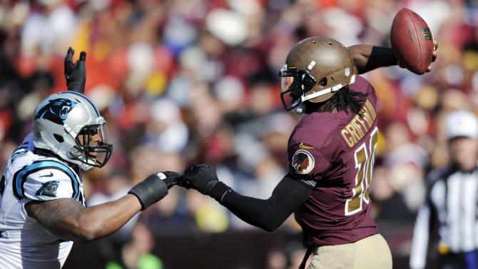 Carolina Panthers defensive end Greg Hardy (76) pressures Washington Redskins quarterback Robert Griffin III (10) during the first half of an NFL football game Sunday, Nov. 4, 2012, in Landover, Md. (AP Photo/Nick Wass)