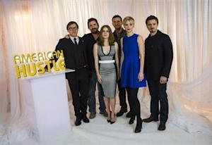 """""""American Hustle"""" director David O. Russell poses for a portrait with cast members Christian Bale, Amy Adams, Bradley Cooper, Jennifer Lawrence and Jeremy Renner in New York December 8, 2013. REUTERS/Eric Thayer/Files"""