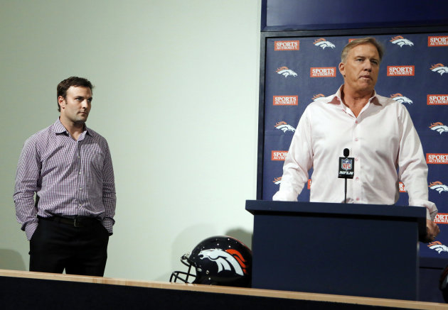 Denver Broncos Vice President John Elway, right, introduces wide receiver Wes Welker at a news conference at the NFL football team's headquarters in Englewood, Colo., on Thursday, March 14, 2013. The former New England star receiver and longtime favorite target of Tom Brady signed a two-year deal with the Broncos on Tuesday. (AP Photo/Ed Andrieski)