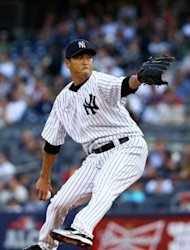 Hiroki Kuroda of the New York Yankees throws a pitc during their game against the Detroit Tigers on October 14. He hurled five perfect innings before Jhonny Peralta singled to centerfield in the sixth and Detroit began the scoring in the seventh on a blunder by Robinson Cano