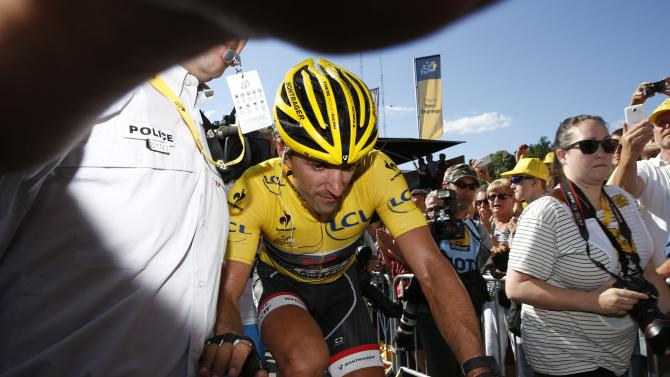 Race leader and yellow jersey holder Trek Factory rider Fabian Cancellara of Switzerland reacts at the end of the 159,5 km third stage of the 102nd Tour de France cycling race from Anvers to Huy