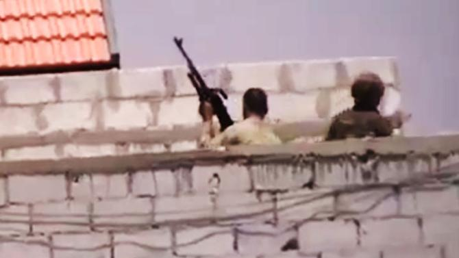 This image made from amateur video released by the Ugarit News and accessed Tuesday, July 31, 2012, purports to show Syrian government forces in Damascus, Syria. (AP Photo/Ugarit News via AP video) THE ASSOCIATED PRESS IS UNABLE TO INDEPENDENTLY VERIFY THE AUTHENTICITY, CONTENT, LOCATION OR DATE OF THIS HANDOUT PHOTO
