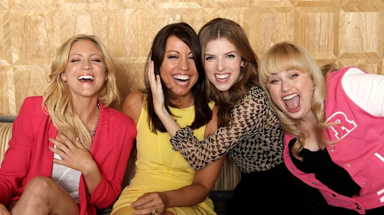 "In this image taken on Friday, Sept. 21, 2012, from left, actress Brittany Snow, screenwriter Kay Cannon, actress Anna Kendrick, actress Rebel Wilson, from the film ""Pitch Perfect,"" pose for a portrait at The London Hotel, in West Hollywood, Calif. Funny women are flourishing in comedies that are produced and written by women. (Photo by Matt Sayles/Invision/AP)"