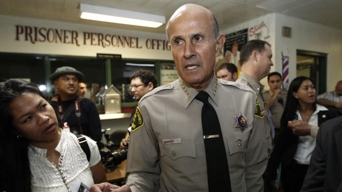 Los Angeles County Sheriff Lee Baca, who is supervises the largest jail system in the nation, talks to reporters at the Men's Central Jail in downtown Los Angeles Wednesday, Oct. 3, 2012. Baca says he plans to implement all the reforms suggested by a commission in the wake of allegations that a culture of violence flourished in his jails. (AP Photo/Reed Saxon)
