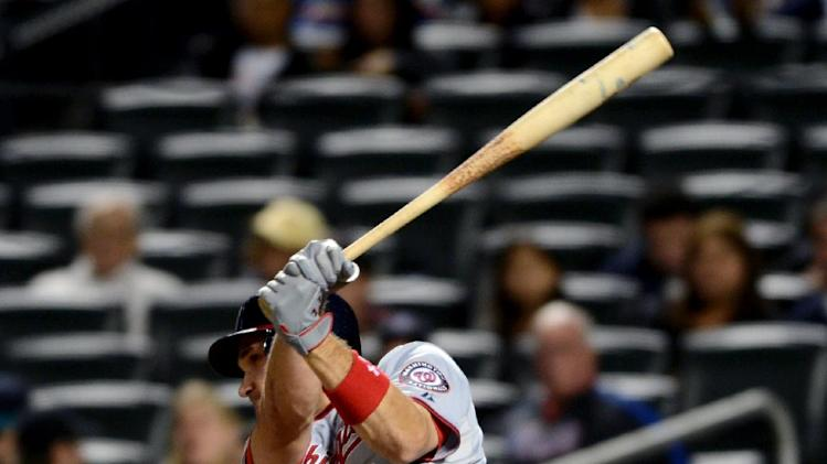 Washington Nationals' Ryan Zimmerman hits a two-run home run in the third inning of a baseball game against the New York Mets in New York, Monday, Sept. 10, 2012. (AP Photo/Henny Ray Abrams)