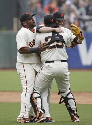 San Francisco Giants pitcher Tim Lincecum is embraced by catcher Hector Sanchez as third baseman Pablo Sandoval, left. joins them after Lincecum threw a no-hitter against the San Diego Padres in a baseball game Wednesday, June 25, 2014, in San Francisco. Lincecum threw his second career no-hitter as San Francisco won 4-0. (AP Photo/Eric Risberg)