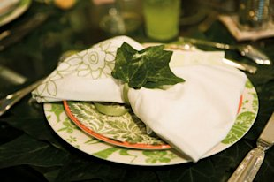 A natural theme gets the right look from Linens made of organic cotton, right, and hand-painted dishes.
