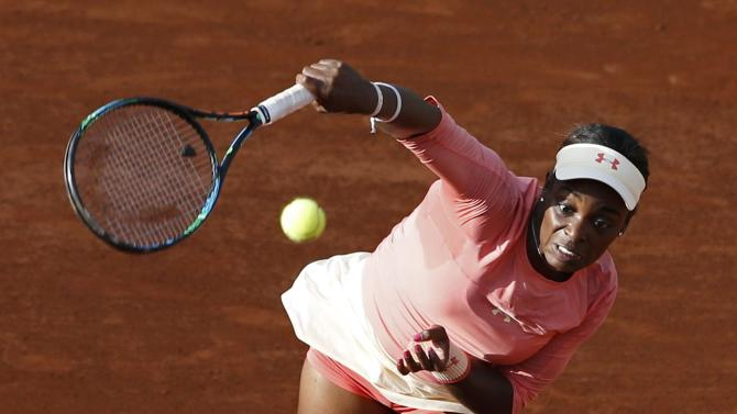 Sloane Stephens of the the U.S. plays a shot to compatriot Venus Williams during their women's singles match at the French Open tennis tournament at the Roland Garros stadium in Paris