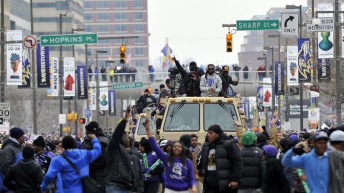 Baltimore Ravens fans break through barriers and walk with players during a victory parade Tuesday, Feb. 5, 2013, in Baltimore. The Ravens defeated the San Francisco 49ers in NFL football's Super Bowl XLVII 34-31 on Sunday. (AP Photo/Gail Burton)