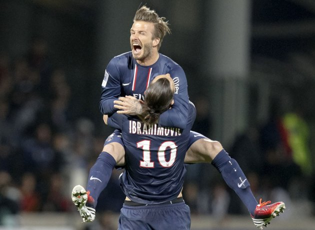 File photo of Paris Saint-Germain's Ibrahimovic and Beckham celebrating during French Ligue 1 soccer match against Olympique Lyon