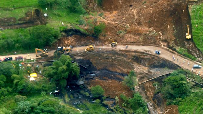 This photo released by Petroecuador Tuesday, June 4, 2013 shows an aerial view of an oil spill caused when a landslide damaged a main pipeline of Ecuador's state oil company, near the volcano El Reventador, in Ecuador's Amazonian region, Friday, June 1, 2013. The Friday landslide damaged the trans-Ecuador pipeline, causing the spill of some 420,000 gallons (1.6 million liters) of crude oil. Some entered the Coca river, a tributary of the Amazon that also flows through Peru and Brazil. (AP Photo/ Petroecuador)
