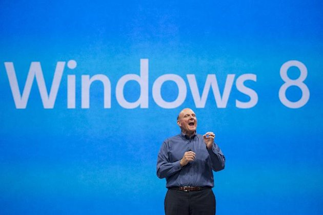 FILE- In this Monday, June 18, 2012, file photo, Microsoft CEO Steve Ballmer comments on the Windows 8 operating system before unveiling its new Surface, a tablet computer to compete with Apple&#39;s iPad at Hollywood&#39;s Milk Studios in Los Angeles. Microsoft Corp. reports quarterly financial results after the market closes on Thursday, July 19, 2012. (AP Photo/Damian Dovarganes, File)