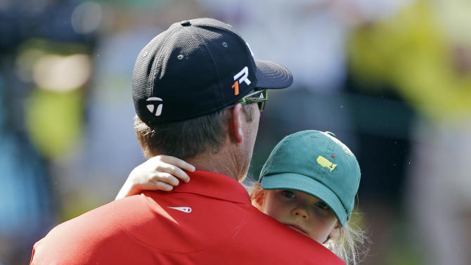 D.A. Points carries his three-year-old Layla during the par three competition before the Masters golf tournament Wednesday, April 10, 2013, in Augusta, Ga. (AP Photo/David Goldman)