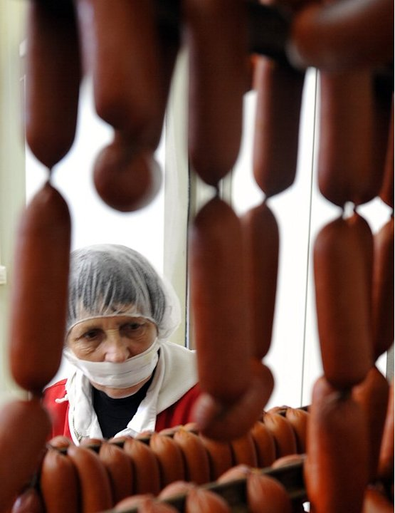 A Bosnian worker prepares sausages for packaging, at a local food factory near Sarajevo, on May 16, 2013