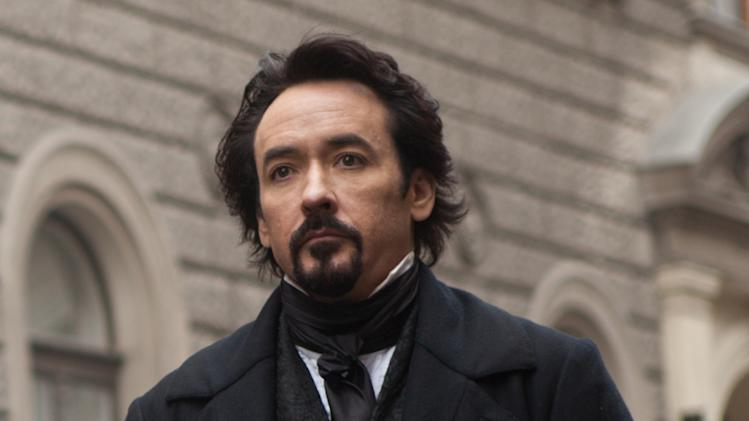 "In this film publicity image released by Relativity Media, John Cusack portrays Edgar Allan Poe in a scene from the gothic thriller ""The Raven."" (AP Photo/Relativity Media, Larry Horricks)"