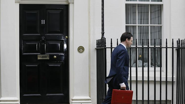 Britain's Chancellor George Osborne leaves his official residence at No 11 Downing Street in London to deliver his annual budget speech to the House of Commons in London, Wednesday, March 20, 2013. (AP Photo/Kirsty Wigglesworth)