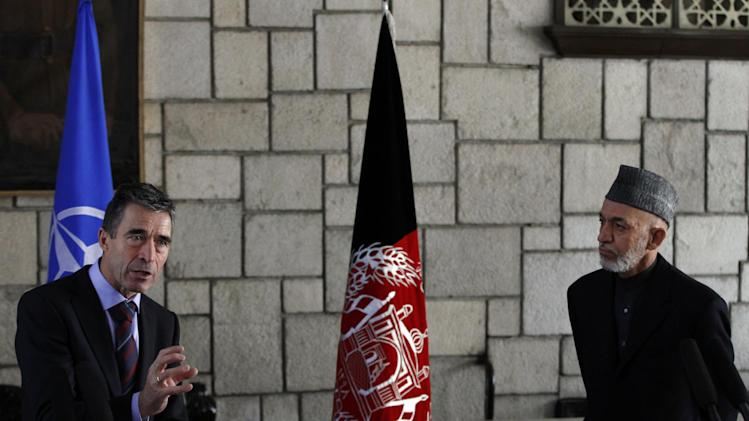 NATO Secretary-General Anders Fogh Rasmussen, left, answers a question during a joint press conference with Afghan President Hamid Karzai at the presidential palace in Kabul, Afghanistan, Monday, March, 4, 2013. Afghan President Hamid Karzai lashed out once again at his supposed ally, Pakistan, saying Monday that a statement by a Pakistani cleric endorsing suicide bombings in Afghanistan shows the neighboring country is not sincere in efforts to fight terrorism. (AP Photo/Ahmad Jamshid)