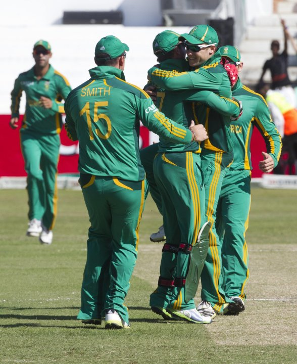 South Africa players celebrate the wicket of Pakistan's Kamran Akmal during their fourth One Day International cricket match in Durban