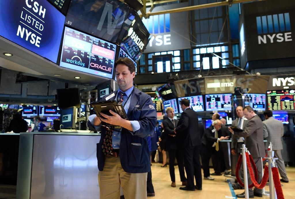 Wall St rebounds amid more wild swings in global markets