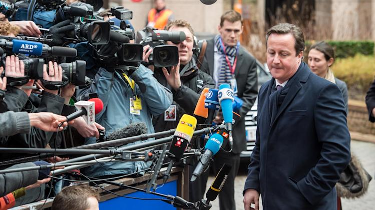 British Prime Minister David Cameron faces tbe media as he arrives during an EU Budget summit at the European Council building in Brussels, Thursday, Feb. 7, 2013. European Union leaders braced for all-night negotiations in Brussels to try and strike a deal on EU spending for the next seven years,  after the summit start was delayed by some hours. (AP Photo/Geert Vanden Wijngaert)