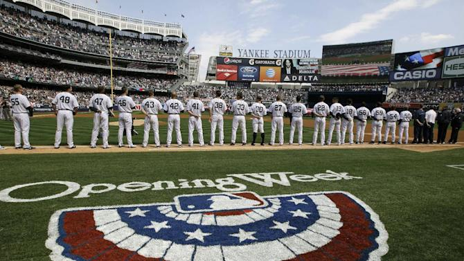 New York Yankees players line up on the baseline during introductions and a tribute to the Newtown, Ct., school shooting victims at an Opening Day baseball game at Yankee Stadium in New York, Monday, April 1, 2013.  (AP Photo/Kathy Willens)