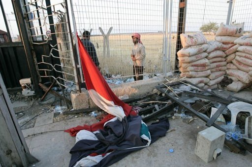 Free Syrian Army soldiers stand near a fallen Syrian flag at the Bab al-Salam border crossing to Turkey. Arab League nations on Sunday called on Syrian President Bashar al-Assad to swiftly give up power in order to end his country's unrest, Qatar's emir said.